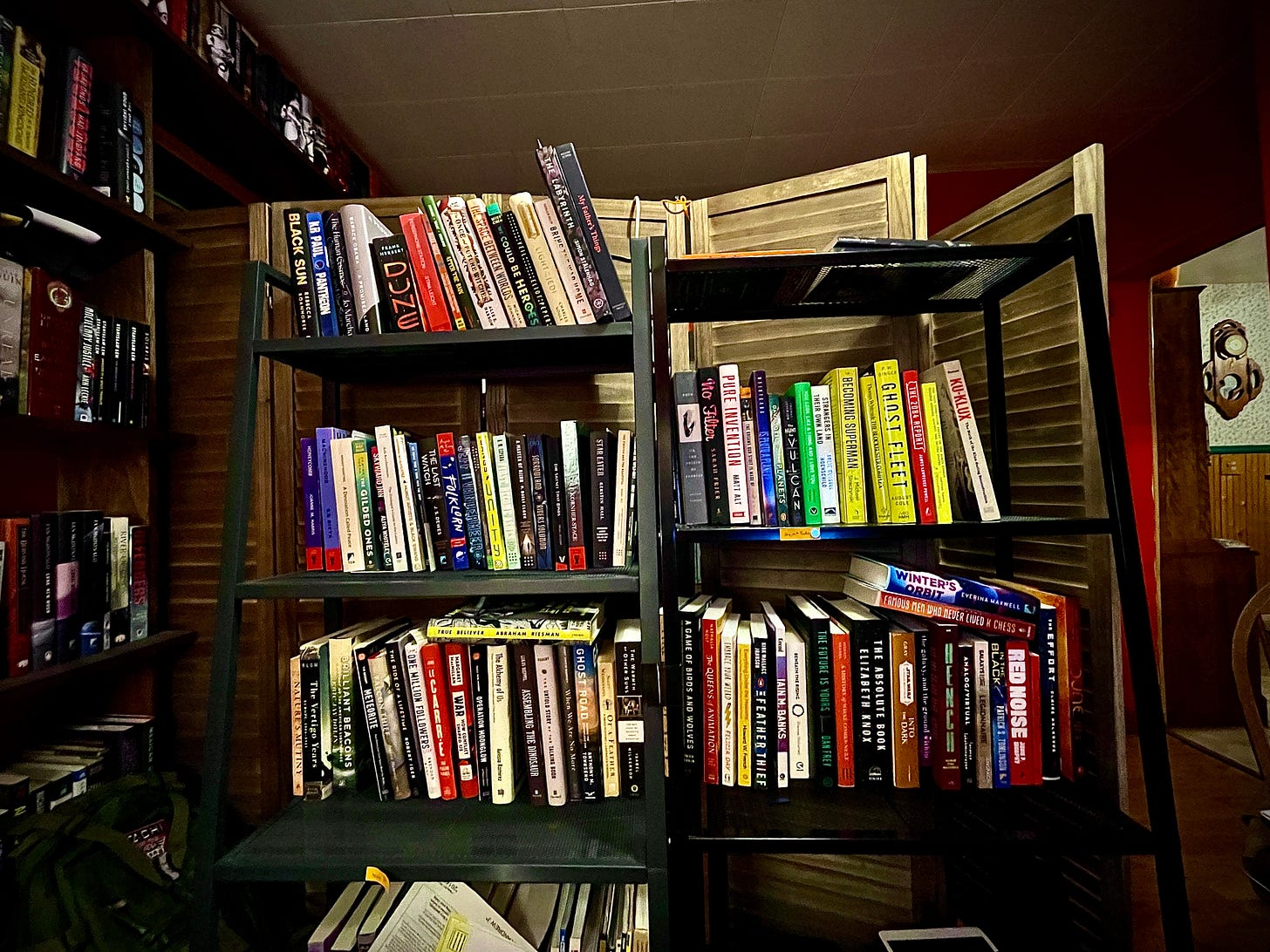 Two bookshelves, loaded down with colorful books.