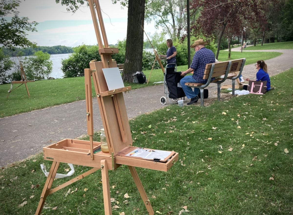 Painters at the park with easels