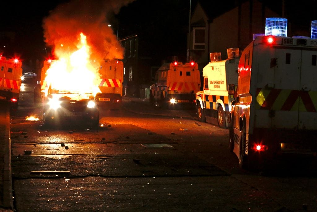 Flames and smoke rise from car set a fire during protests as rioters hurled petrol bombs, fireworks and stones at police amid unrest since Wednesday, in Belfast, Northern Ireland on April 09, 2021. â¨The unrest started when some Sinn Fein members attended a crowded funeral on top of tensions caused by Brexit border arrangements, which brought checks on goods shipped between Northern Ireland and the rest of the UK. â¨Both loyalist and nationalist areas were involved in riots in west Belfast. (Photo by Hasan Esen/Anadolu Agency via Getty Images)