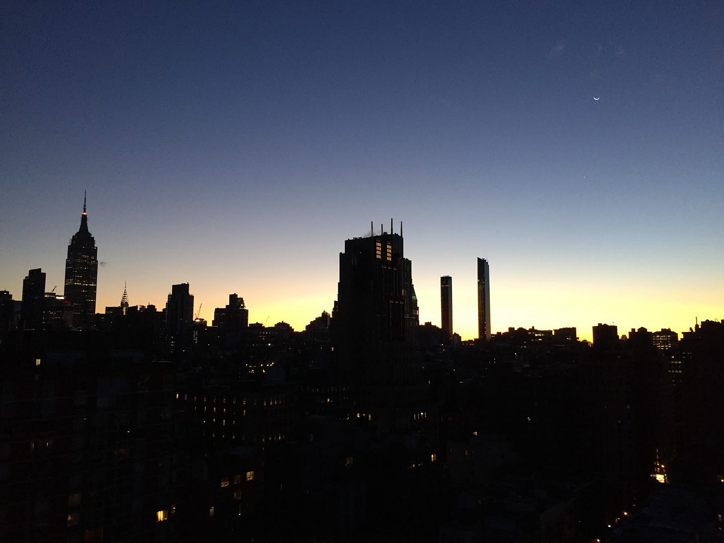 The sun rising across the skyline of New York.