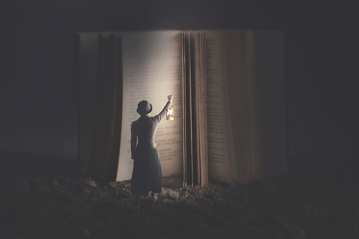 Woman Holding Lamp up to Illuminate Giant Book