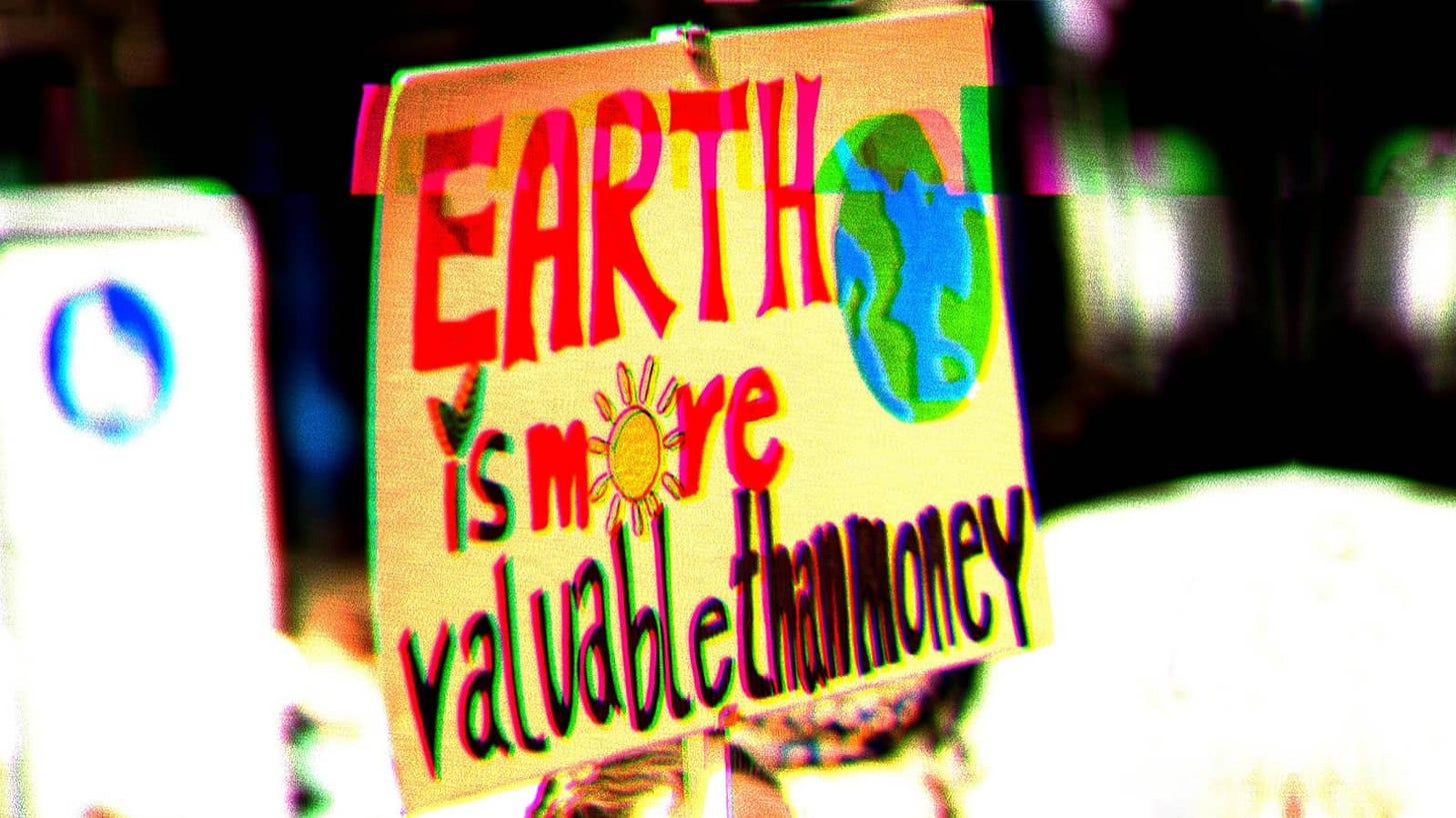 """Protest sign that says, """"Earth is more valuable than money."""""""