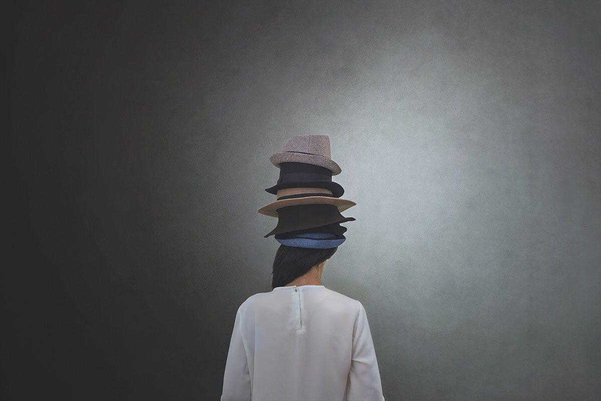 Woman Wearing Multiple Hot Hats