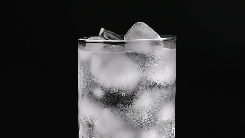 Glass Cup with Ice and Stock Footage Video (100% Royalty-free) 1014081530    Shutterstock