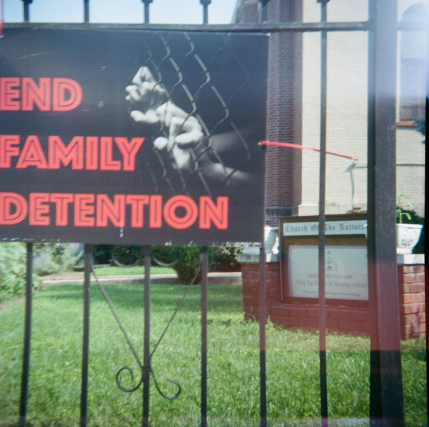 """A sign that says """"End Family Detention"""" on the fence at the Church of the Nativity in Flatbush, Brooklyn"""