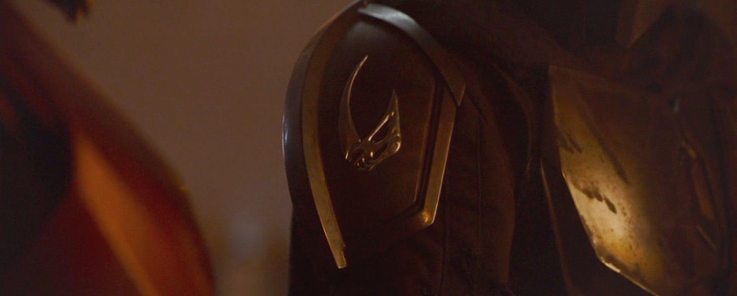 Mandalorian crest on shoulder pad armor
