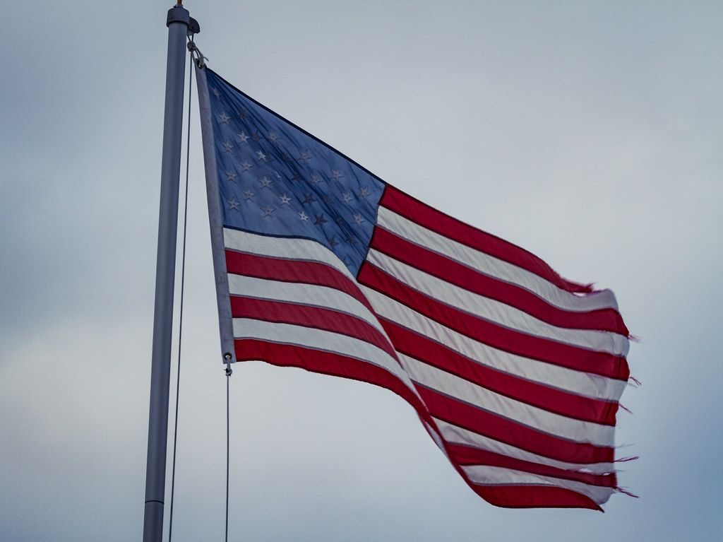 """""""Tattered American Flag"""" by Tony Webster is licensed under CC BY-SA 2.0"""