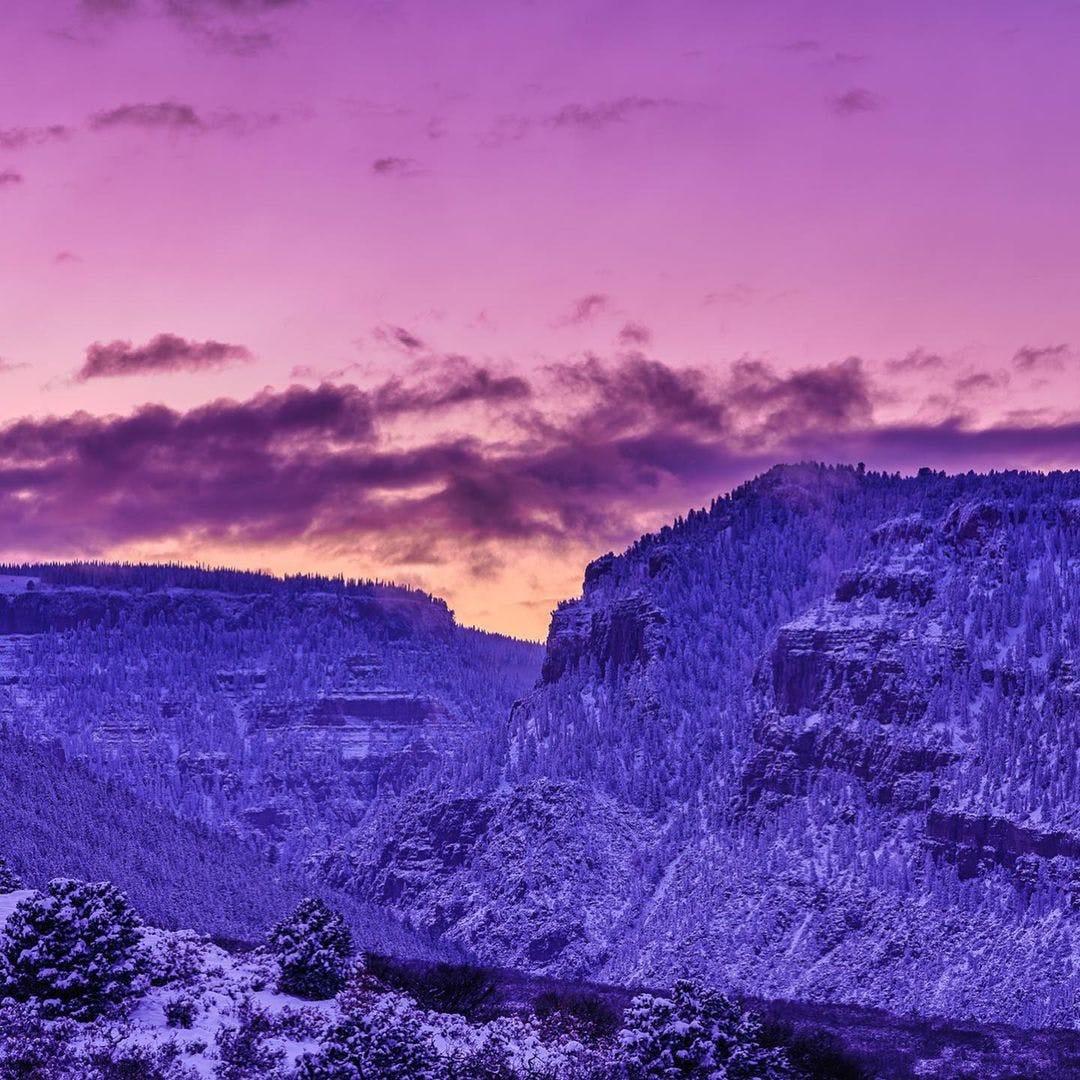 Purple ski over snowy mountains