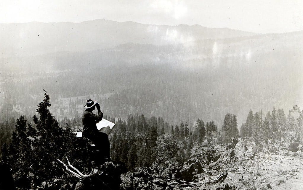 1920. Scouting and mapping areas of beetle kill from a high point. Jenny Creek, Oregon.