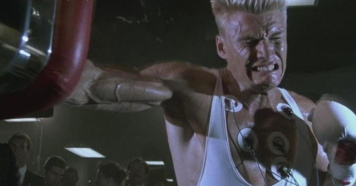 Rocky IV Villain Dolph Lundgren Shows Dolph Lundgren Shows How To Stay Fit  In Isolation With Exercise Band Workout - Maxim