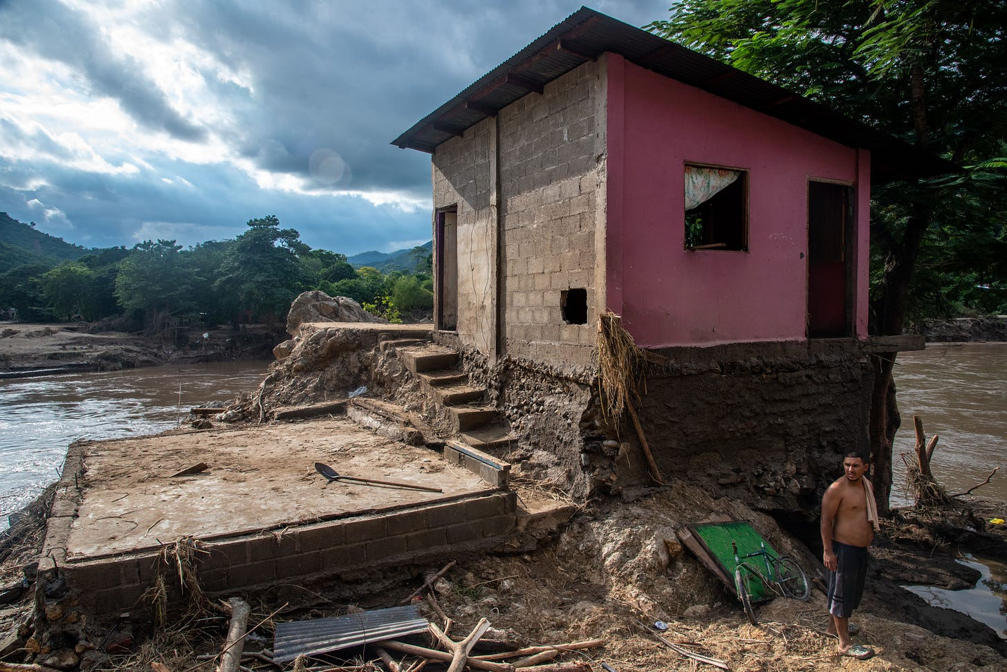 SAN PEDRO SULA, CORTES, HONDURAS - 2020/11/07: A man in front of his home that was destroyed when the Chemelecon River flooded in San Pedro Sula