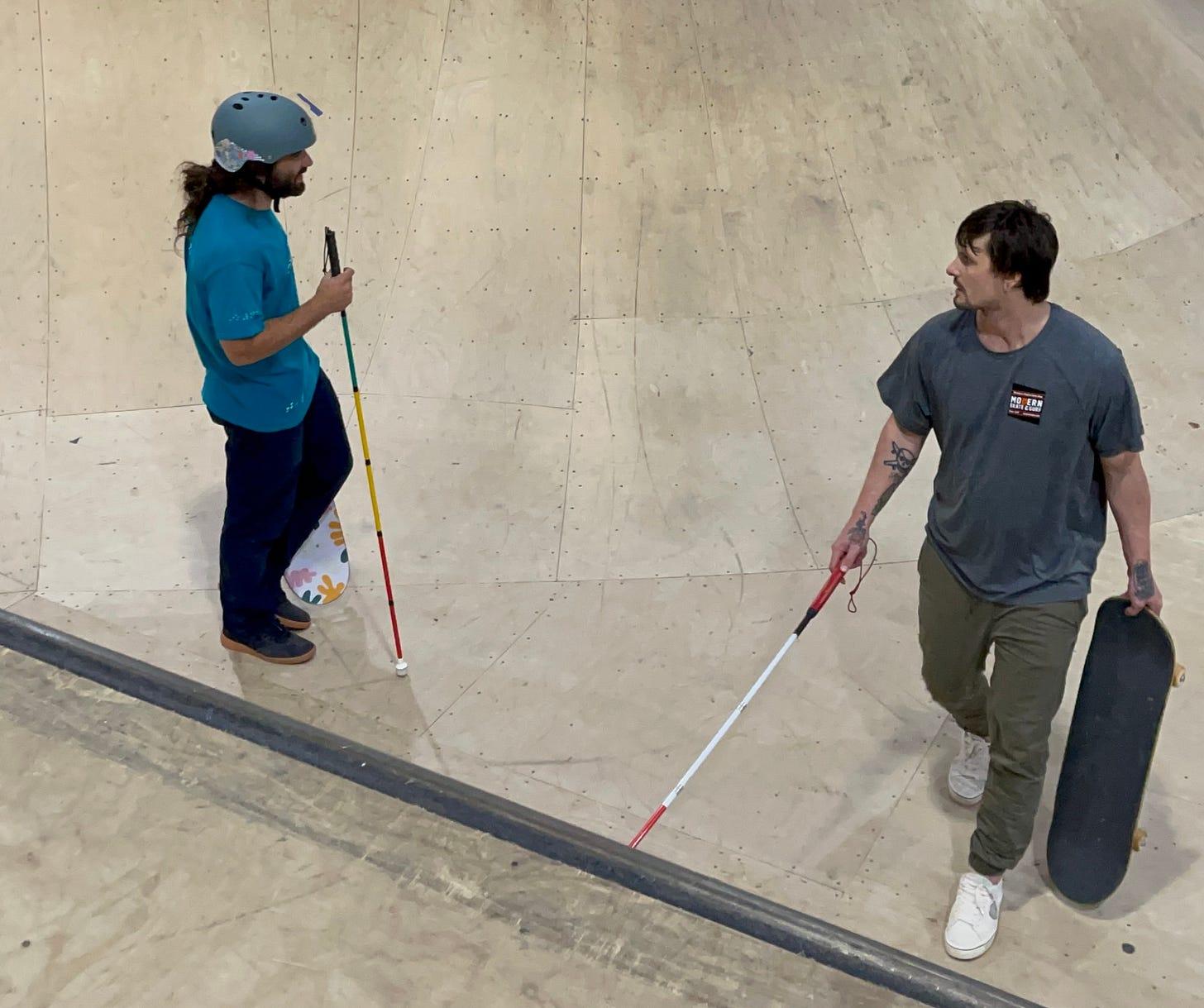 Blind Skater, Anthony Ferraro (left) learns how to navigate the bowl from Blind Skater, Nick Mullins at Modern Skate