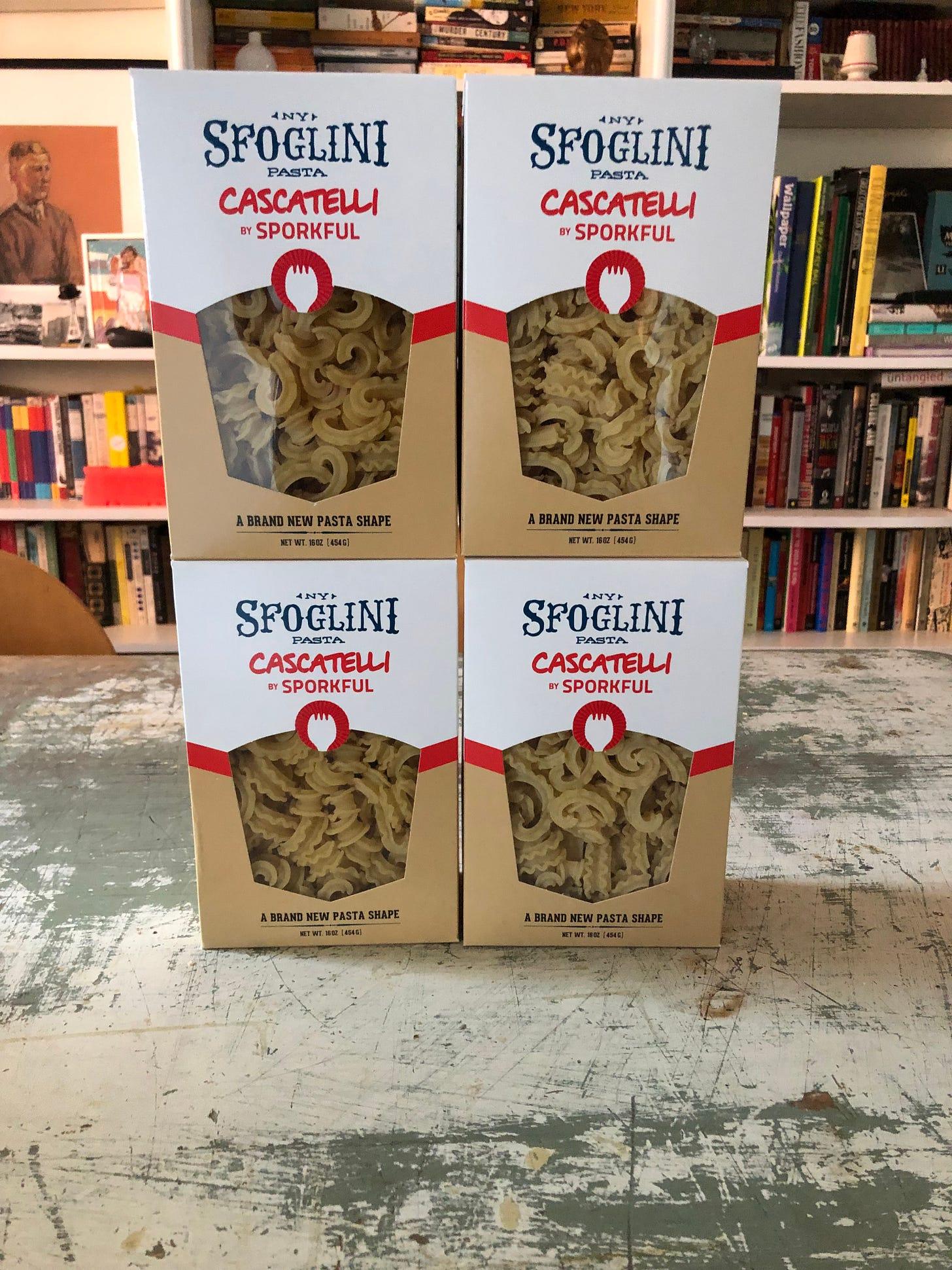 Four boxes of pasta. The boxes read Sfoglini Pasta. Cascatelli by Sporkful. A brand new pasta shape.