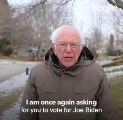 Image may contain: 1 person, outdoor, text that says 'Bernie Iam once again asking for you to vote for Joe Biden'