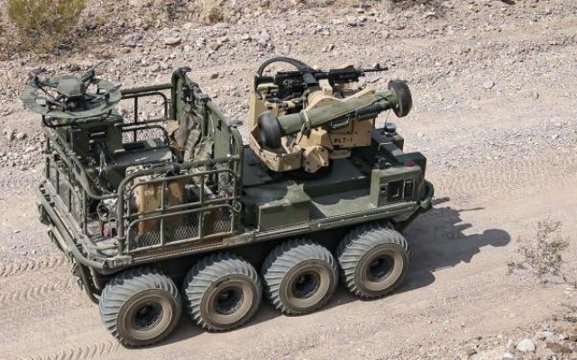 """An Army autonomous weapons system known as """"Origin"""" maneuvers through desert terrain as weapons testing commences during Project Convergence 20 at Yuma Proving Ground, Arizona, August 25, 2020."""