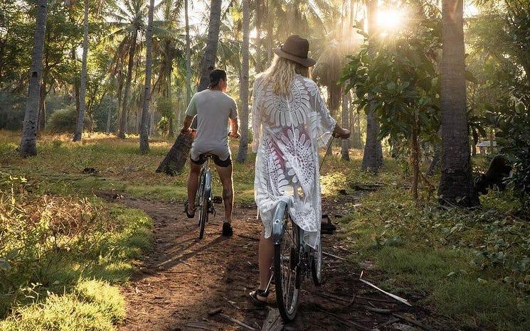 Logan and Tyler bike riding in Bali
