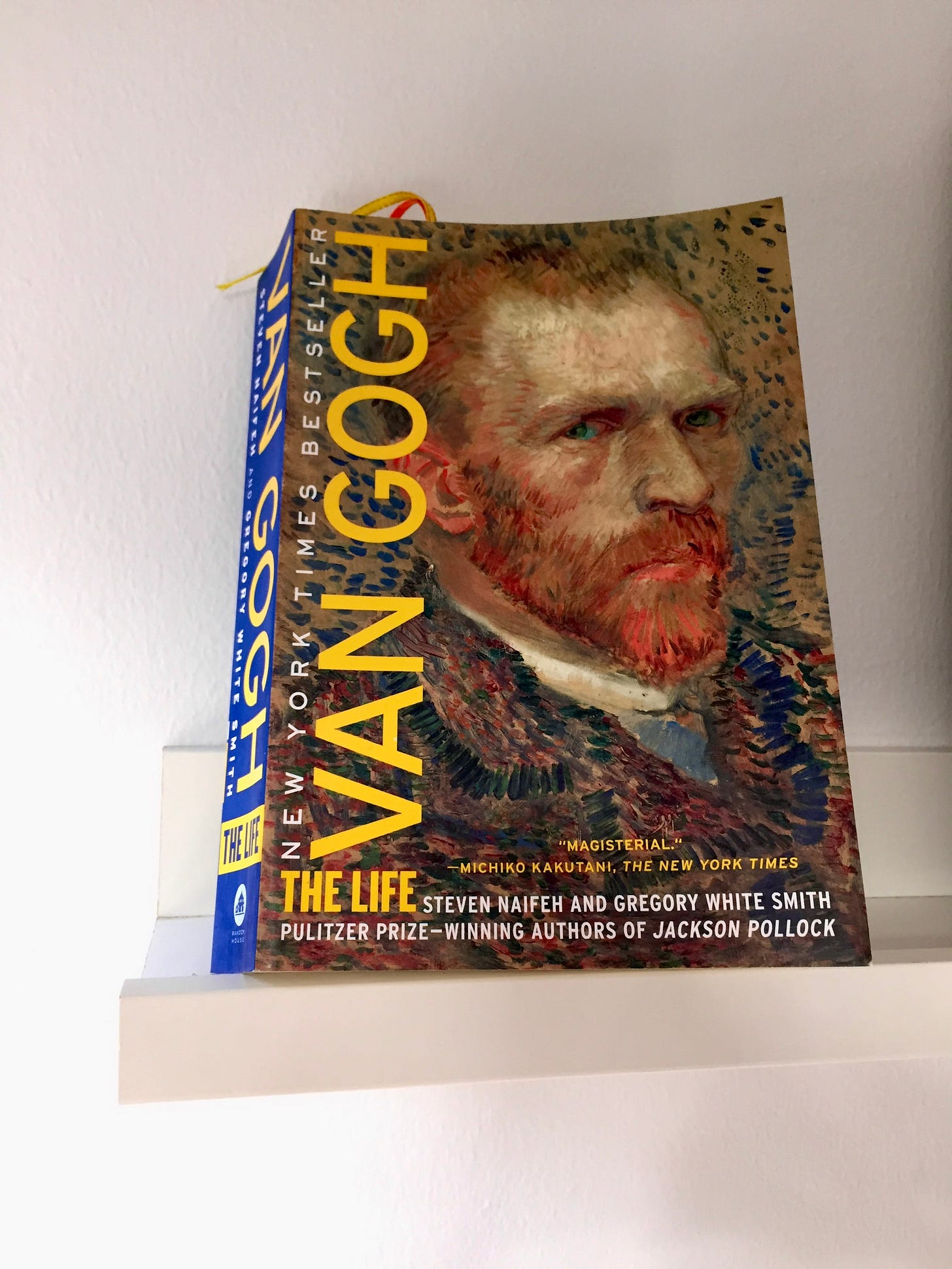 Photo of the book, Van Gogh, The Life by Steven Naifeh and Gregory White Smith. The book cover showed a self-portrait of Vincent van Gogh, his piercing blue eyes seems to be looking intensely at the viewer. He has ginger reddish coloured beard, and his hairline has started to recede. He appeared to be wearing a jacket.