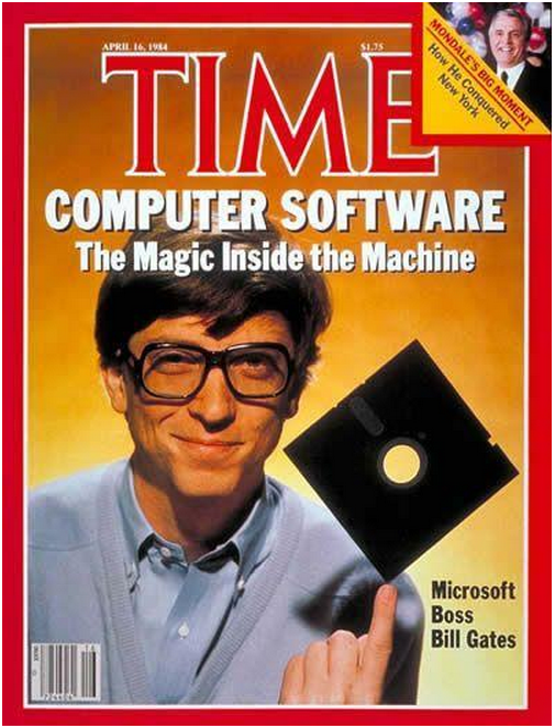 """Time Magazine April 1984 with Bill Gates on the cover. Hes wearing a button down shirt balancing a 5"""" floppy disk on his finger. The title is """"Computer Software: The Magic Inside the Machine"""" caption Microsoft Boss Bill Gates"""