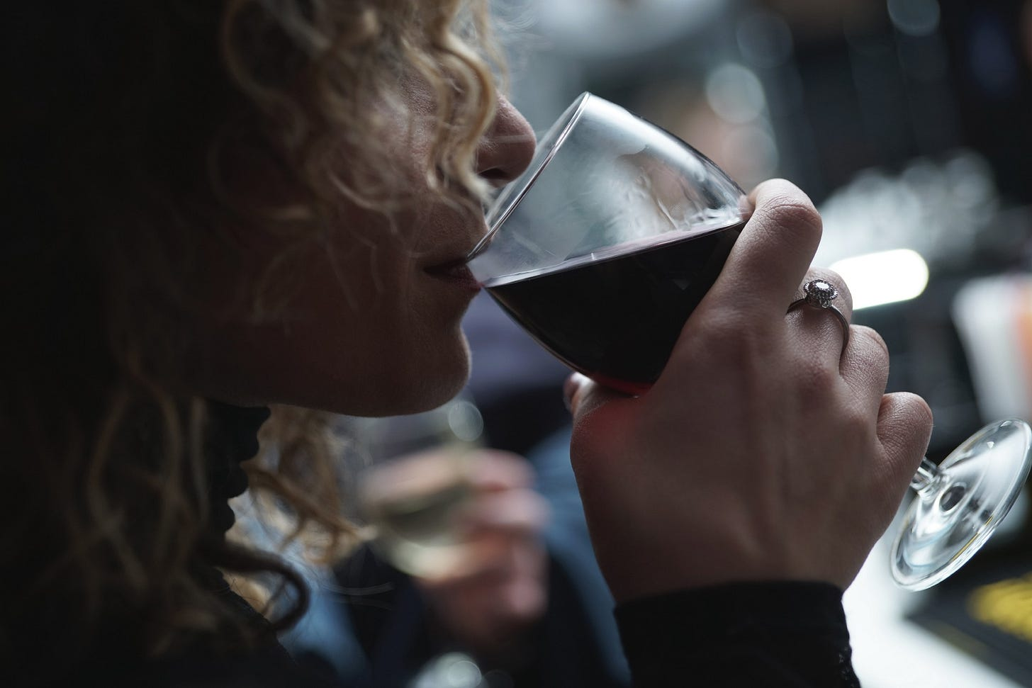 """image of a woman drinking red wine for article titled """"When Two Bottles of Wine Doesn't Work"""""""