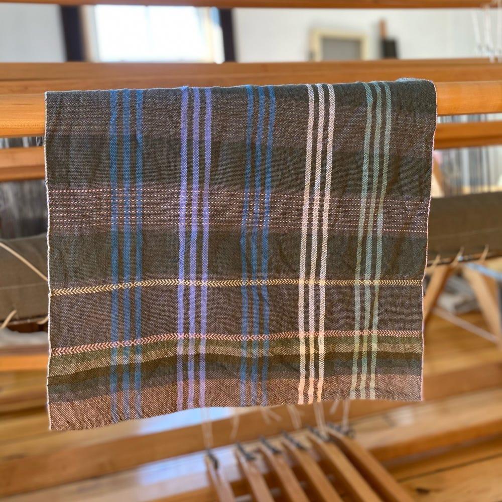tea towel hanging over loom beam