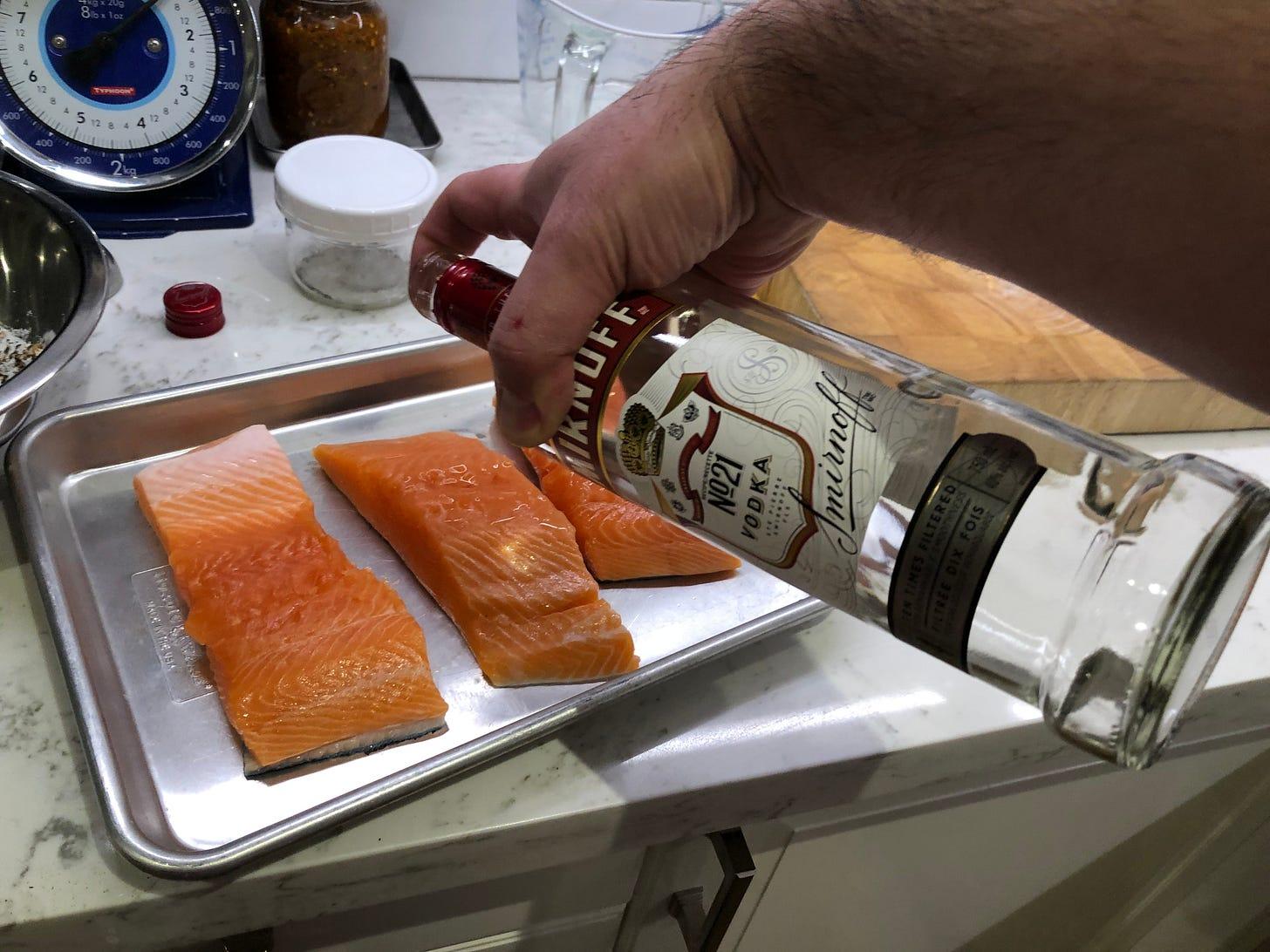 Splashing the salmon pieces with vodka