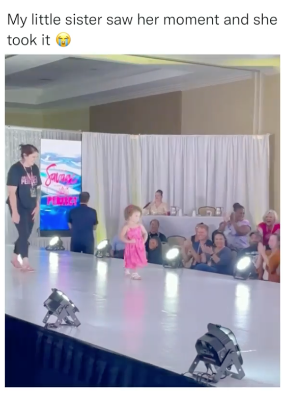 """A screenshot showing the title """"my little sister saw her opportunity and took it"""". Below is a catwalk with an audience clapping, a small girl in pink with her hands on her hips standing in the center, and someone who looks to be following her to collect her."""
