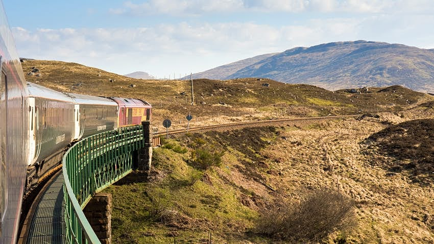 Rannoch, Scotland - May 11, 2016: The Caledonian Sleeper train crosses Rannoch Viaduct on the scenic West Highland Line railway in the Scottish Highlands.