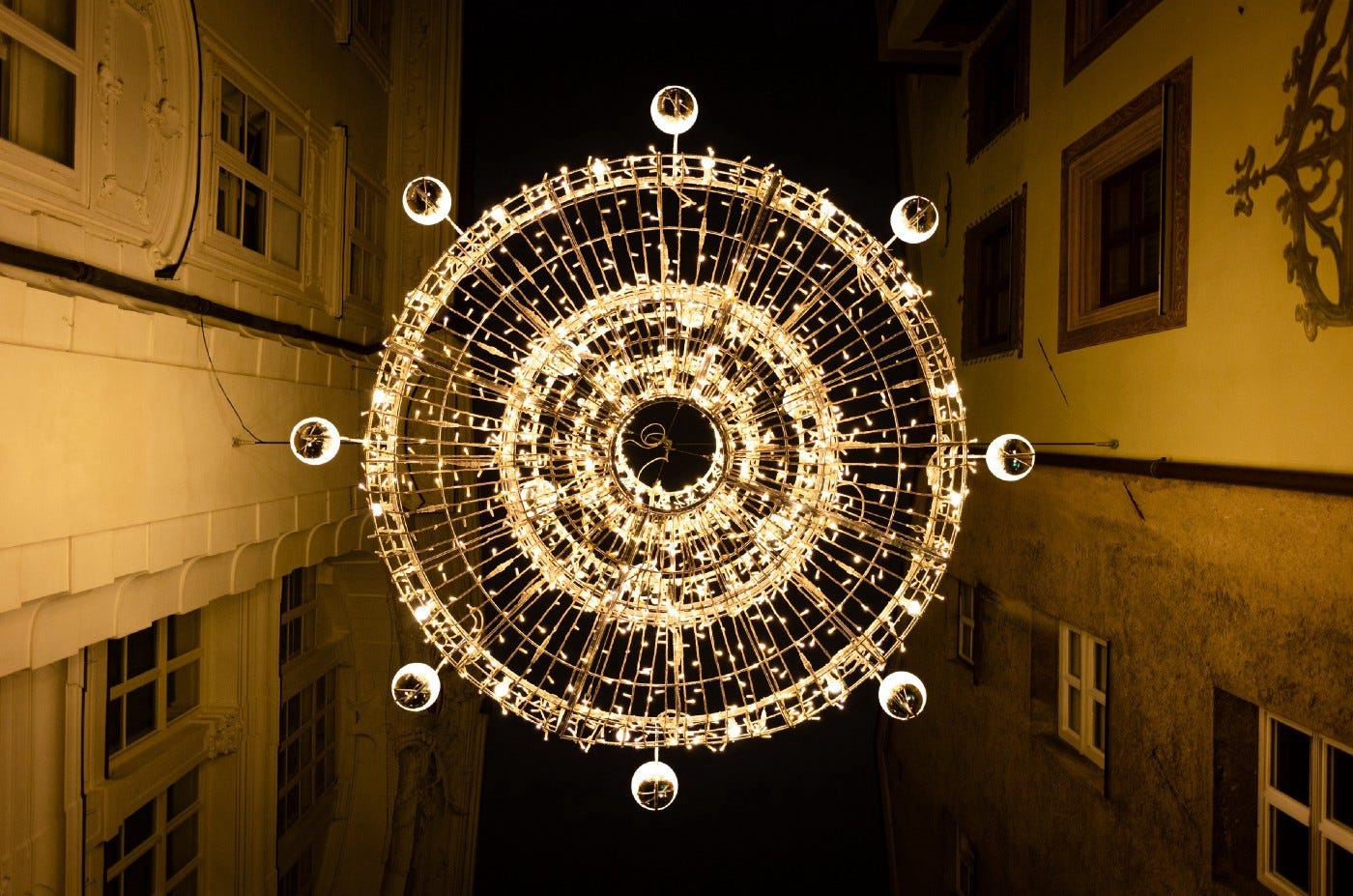 A chandelier photographed from directly below.