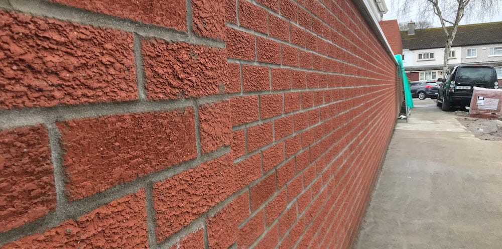Image of a brick wall built with skill and attention to detail