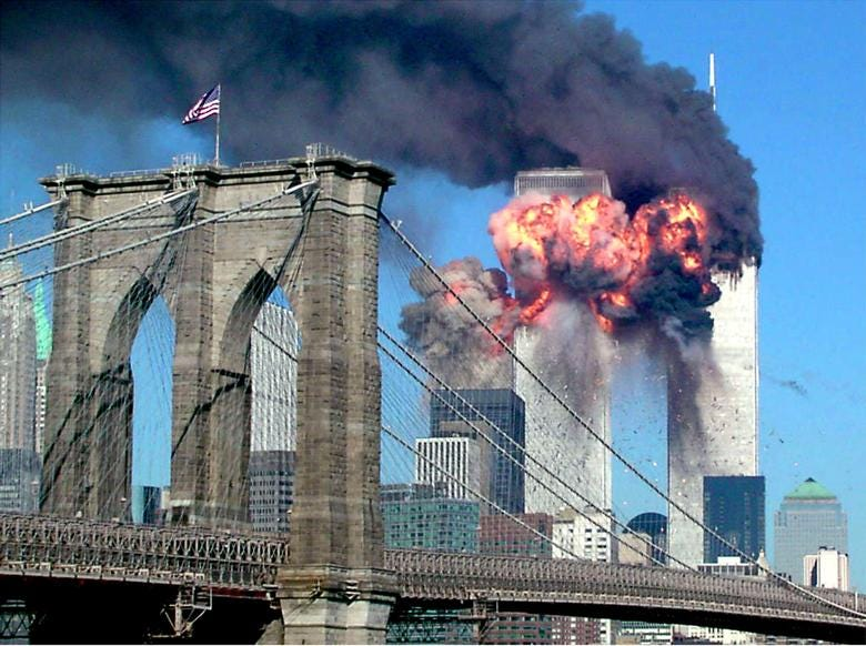 The second tower of the World Trade Center bursts into flames after being hit by a hijacked airplane, September 11, 2001. REUTERS/Sara K. Schwittek