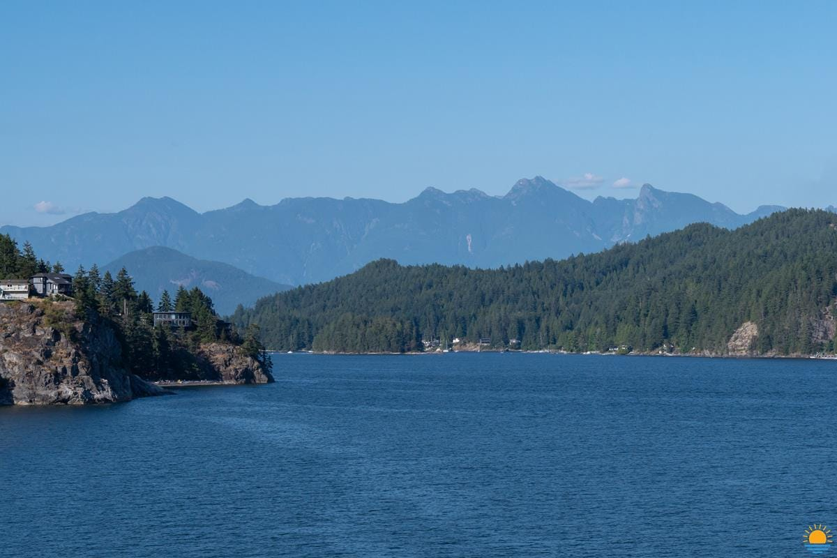 Looking towards Gibsons, BC from Gospel Rock. That's the Bluff on the left, Keats Island is on the right, Gambier Island is behind Keats, and in the distance are the North Shore Mountains.