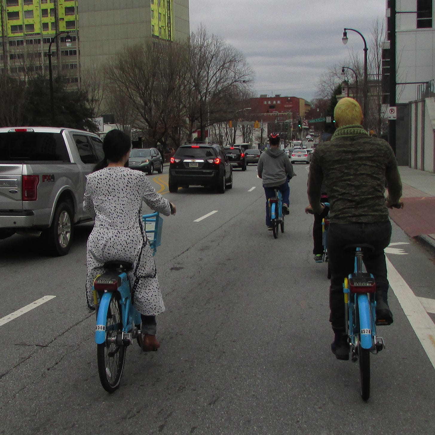 Photo showing two people riding bikes side by side