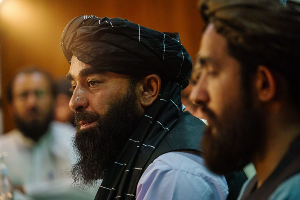 Taliban spokesman Zabihullah Mujahid speaks at a press conference Tuesday in Kabul, Afghanistan, (Marcus Yam / Getty Images)