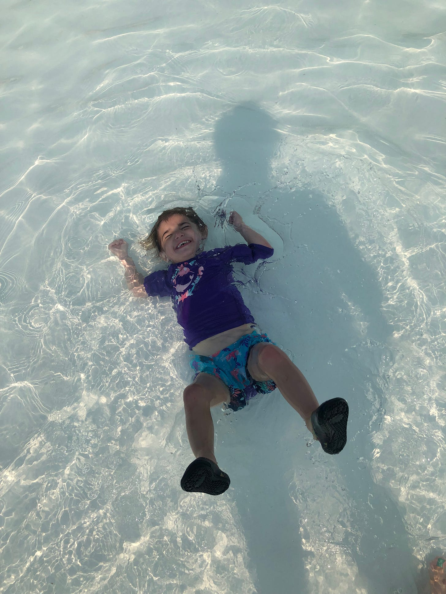Photograph of a gleeful toddler in a wave pool