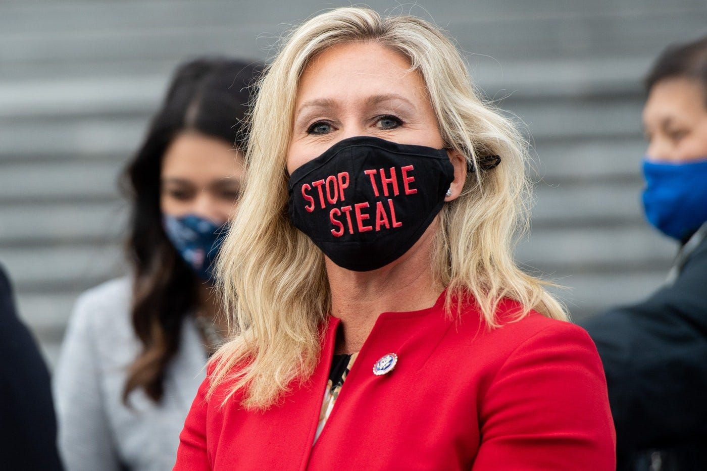 "Marjorie Taylor Greene wears a ""Stop The Steal"" mask."