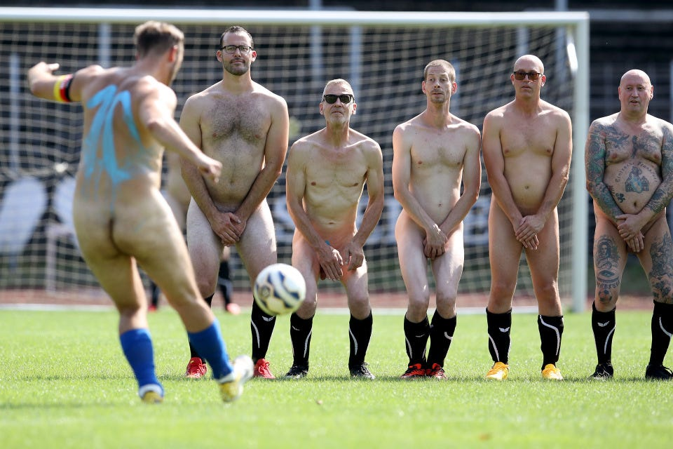 A naked wall gear up for a free kick during a German game