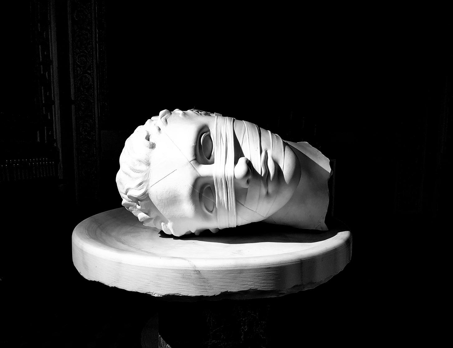 Sculpture of the bandaged, severed head of St. John the Baptist in the Santa Maria degli Angeli e dei Martiri, Baths of Diocletian, Rome.