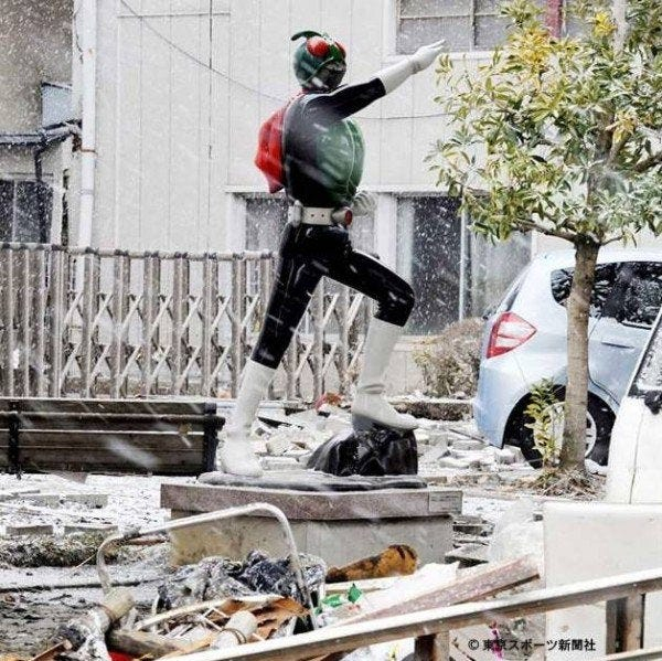 Kamen Rider statue stands untouched after the 2011 Earthquake/Tsunami