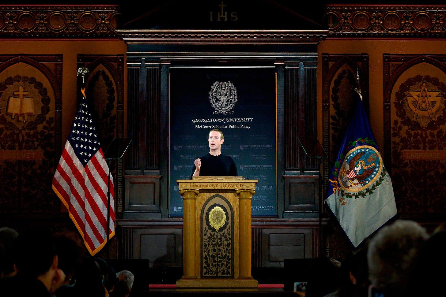 Mark Zuckerberg speaks at a podium at Georgetown University