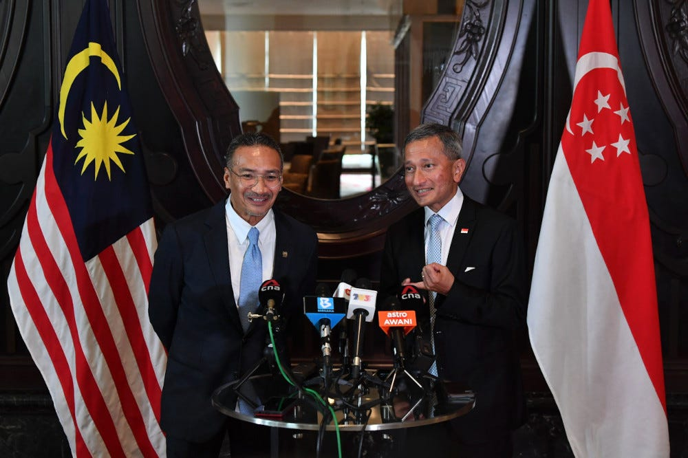 Foreign Minister Hishammuddin Hussein with his Singapore counterpart Dr Vivian Balakrishnan hold a joint press conference after a bilateral meeting in Putrajaya, March 23, 2021. — Bernama pic