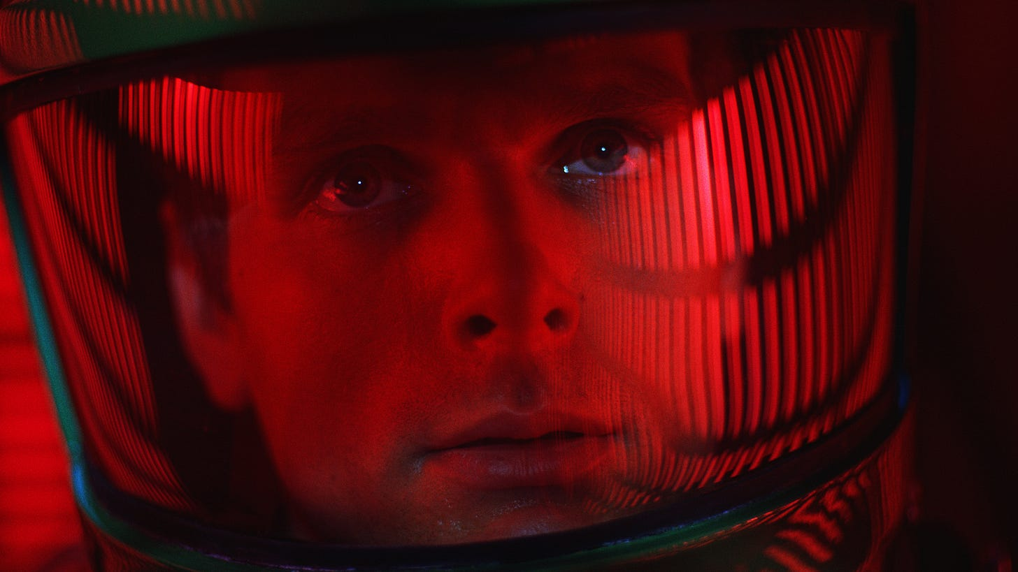 2001: A Space Odyssey Dave looks up in his red tinted helmet