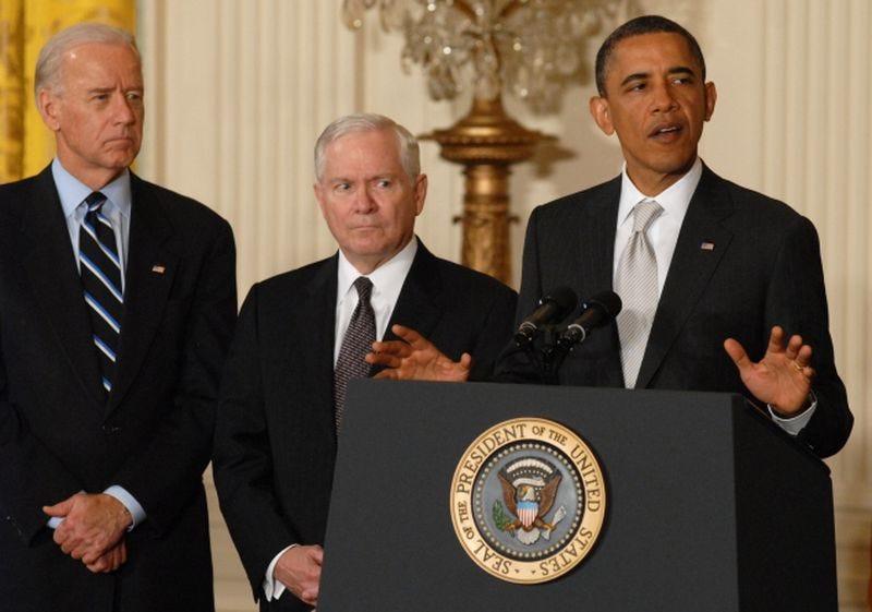 President Barack Obama (right) stands with Vice President Joe Biden (left) and former Defense Secretary Robert Gates (center) in 2011.