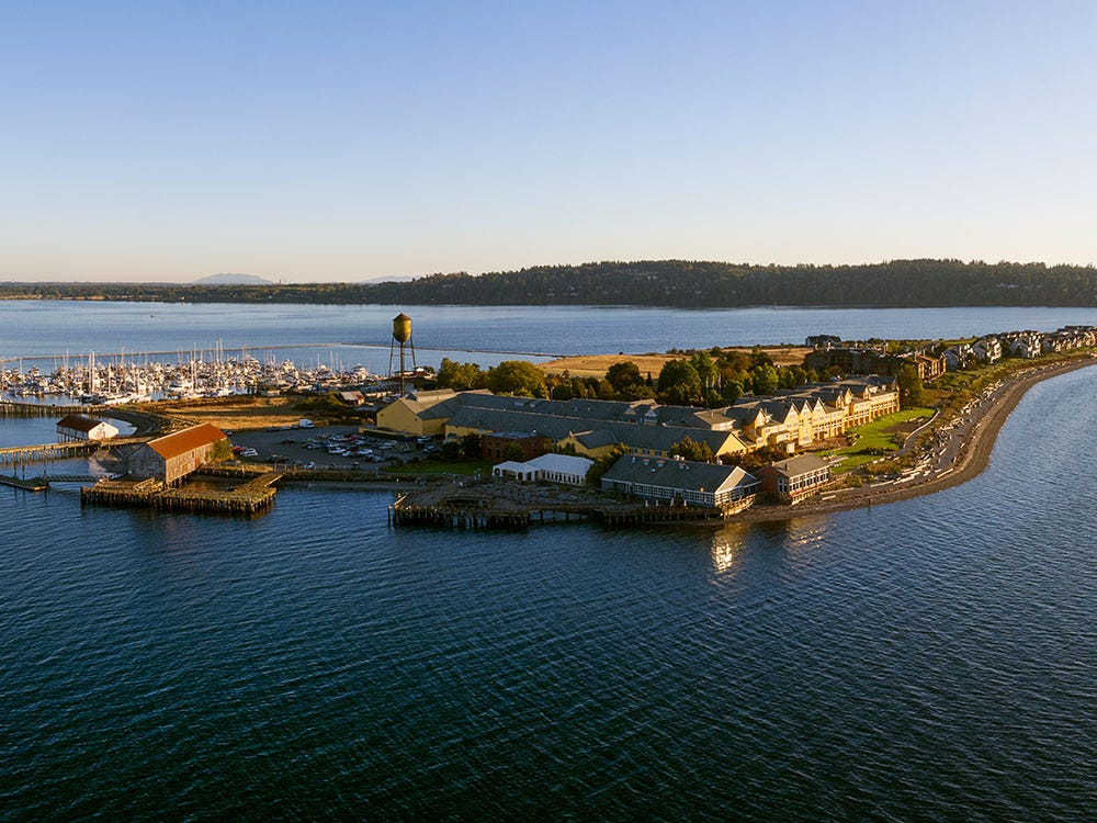 Aerial view of the Semiahmoo resort. Small peninsula with some buildings and docked boats.