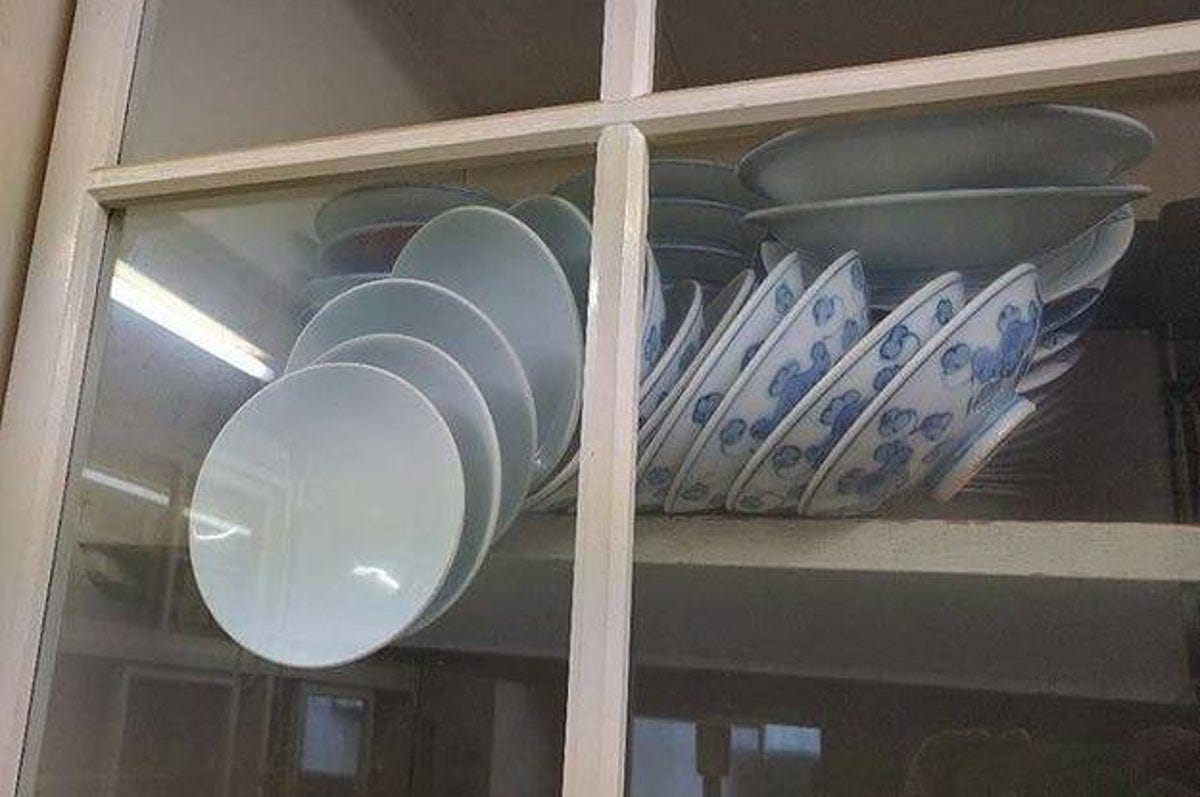 The Viral Photo Of Bowls Trapped In A Cupboard Was Actually Taken During An  Earthquake