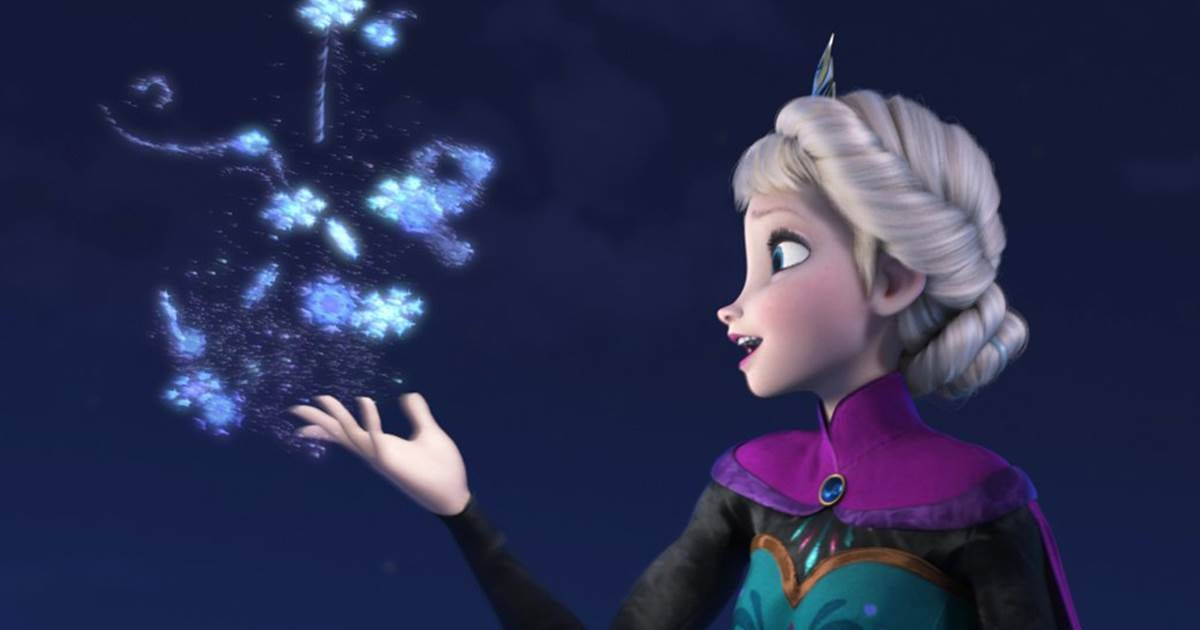 Still from Frozen of Elsa creating snowflakes and looking at the flurry in her hand
