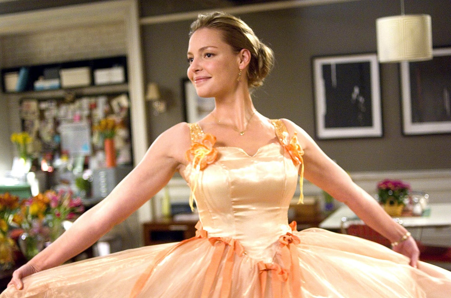 Katherine Heigl in an ugly peach gown in 27 Dresses