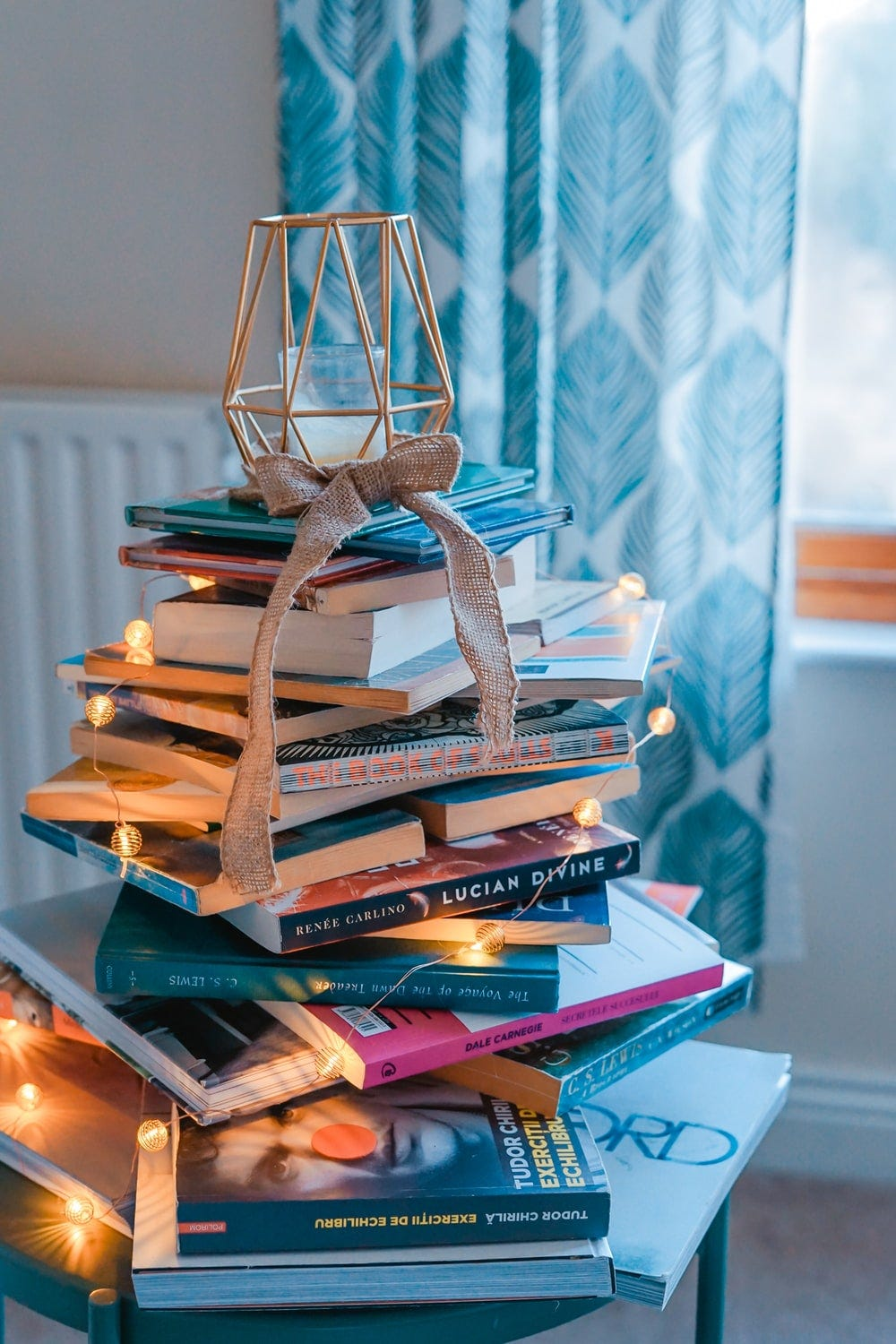 brown wooden framed candle holder on top of books