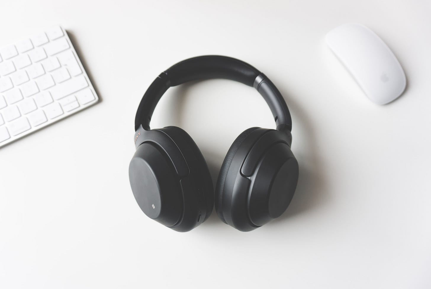 Headphones with a keyboard and mouse