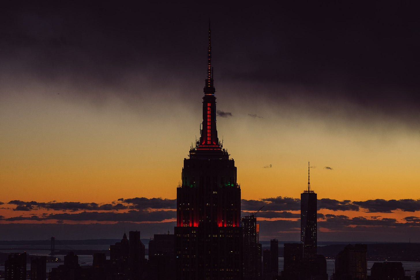 Sunset with the top of the Empire State Building in the centre of the image.