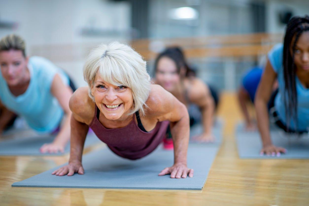 Youthful elder practicing yoga